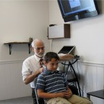 Dr. Brown shown taking a scan along a child's neck